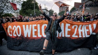 "Demonstrators attend the ""Welcome to Hell"" anti-G20 protest march near Hamburg harbour on July 6."