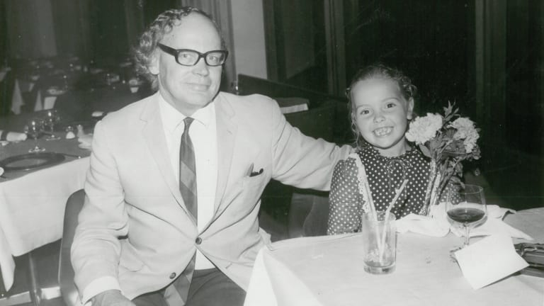 Emma Harcourt with her father Bill on her sixth birthday outing to a revolving restaurant.