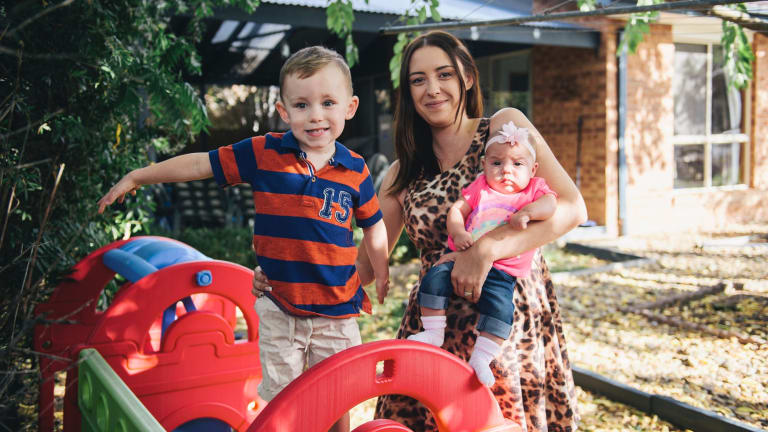 Nicole Tarling with her two children Colby, 3, and Olivia, 5 months, at home in Banks. Most population growth is happening in Canberra's north but Nicole is bucking the trend by raising her children in Tuggeranong.