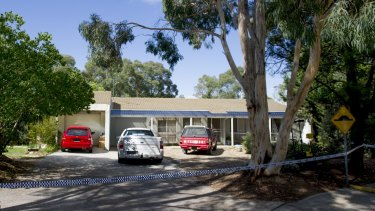 Police tape around a Calwell home where a woman, 28, died on Saturday.