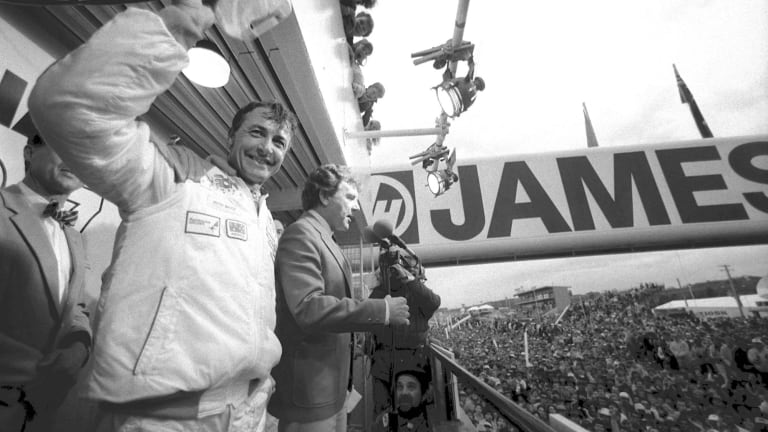 Controversial finish: Peter Brock on the podium after finishing third at Bathurst in 1987. He was later declared the winner after the first and second placed Ford Sierras were disqualified.