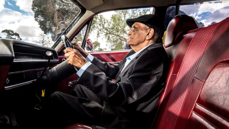 Uncle Herb Patten, who used to drive the hearse for the Aboriginal Funeral Service, gets behind the wheel again to help transport the remains of people including Mungo Man.