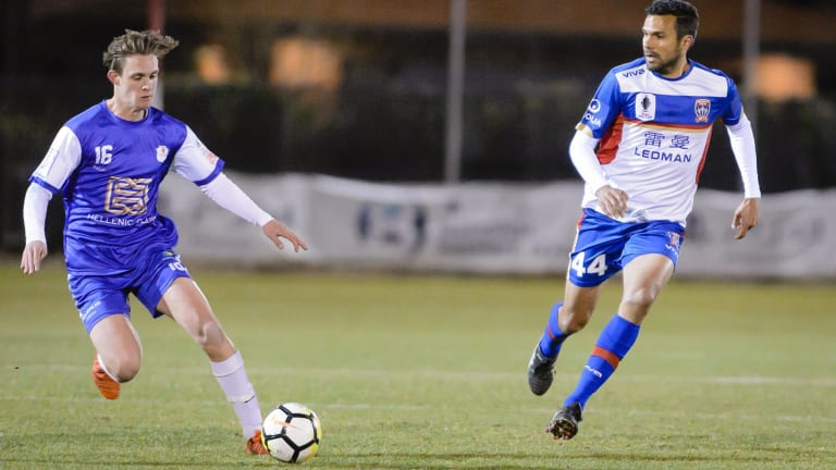 Josh Gulevski [left] playing for Canberra Olympic in a friendly against the Newcastle Jets. Canberra-born Jets skipper Nikolai Topor-Stanley defends.