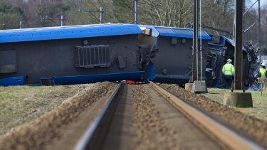 The derailed train lies across the rails near Dalfsen.