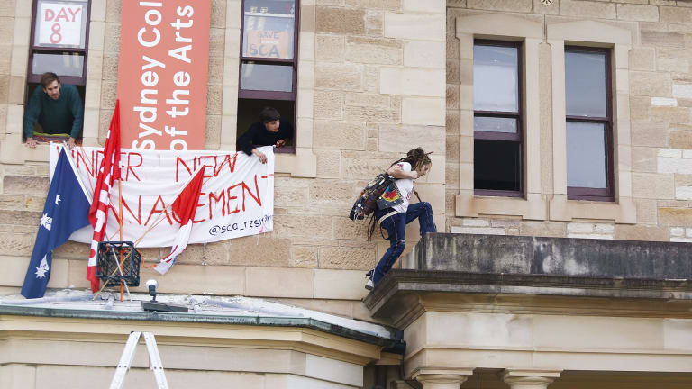 A student climbs to the administration offices of the Sydney College of Arts during a student occupation of the campus in 2016.