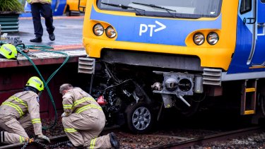 The car wedged under the train on Wednesday afternoon.