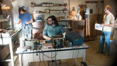 Garage brand: A scene from the biopic <i>Jobs</i> showing Steve Jobs and Steve Wozniak in the Jobs family garage.
