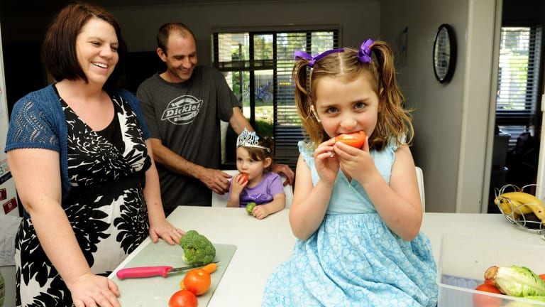 The Harvey family, from left, Ngaire, Chris, Imogen, 3, and Aisha, 5, at home in Kambah. They encourage their children to eat vegetables.
