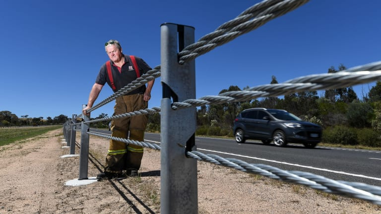 Andy Chapman, Elphinstone CFA captain, inspects wire rope barriers.