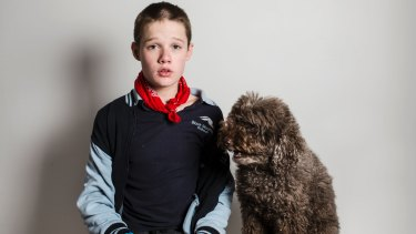 16-year-old Logan with his therapy dog Simi.