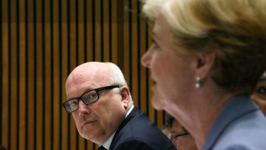 Attorney-General Senator George Brandis and Human Rights Commission president Gillian Triggs during a Senate hearing in Canberra.