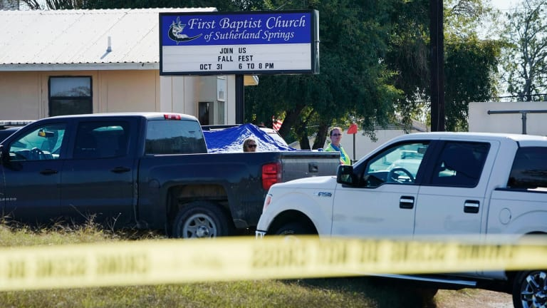 Law enforcement officers work in front of the First Baptist Church of Sutherland Springs after a fatal shooting on Sunday.