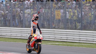 Honda rider, Marc Marquez of Spain, celebrates after winning the San Marino MotoGP on Sunday.