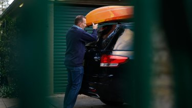 Tony Abbott packs a car before he and Margie leave Kirribilli House for the last time on Friday.