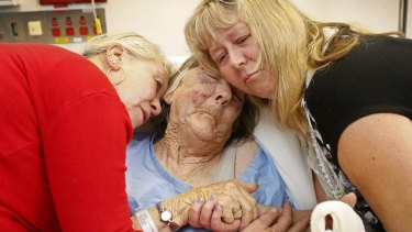 Mavis Dillon is comforted in  Sunshine Hospital after being bashed by a car thief.