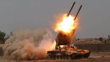 Iraqi security forces launch rockets against Islamic State extremist positions in Tikrit before taking the city.