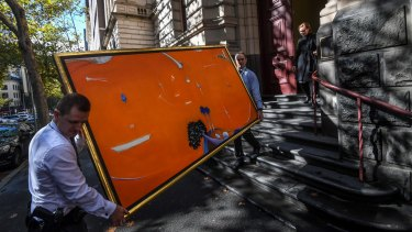 Brett Whiteley's 'Orange Lavender Bay' is carried from the court after Gant and Aman's appeal was heard.