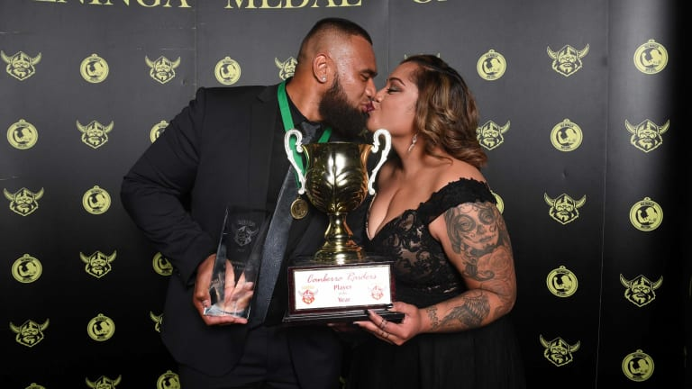 Junior Paulo and partner Mele Paulo celebrate him winning the Mal Meninga Medal.
