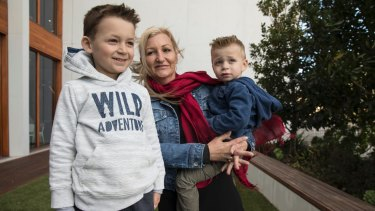 Nikola Barac, 6, with his mother Fiona Stamenkovic and brother Milan outside Westmead Institute for Medical Research.