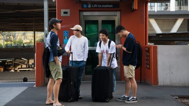 Kodai Yasui, Shuia Kamo, Taichi Matsui and Ugyen Tashi would rather order an Uber outside Wolli Creek Station than catch the train to Sydney Airport.
