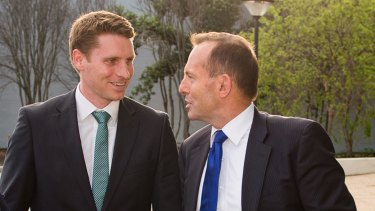 Prime Minister Tony Abbott with Liberal candidate Captain Andrew Hastie  outside the <i>West Australian</i> newspaper offices in Perth on Friday.