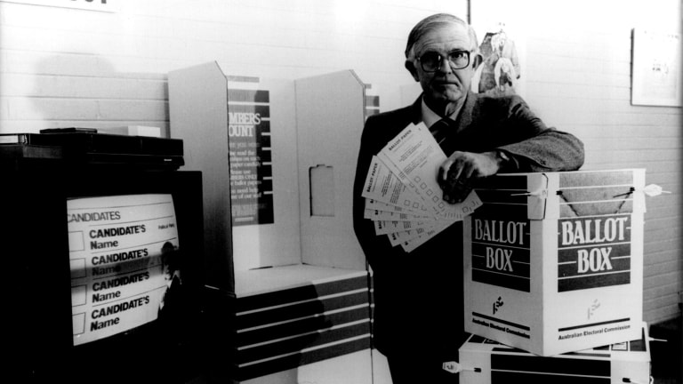 Colin Hughes, the electoral commissioner, publicises then new voting screens and ballot boxes in the 1980s.