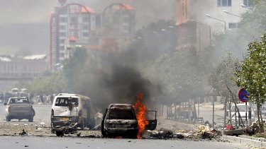 Cars on fire after a Taliban suicide bomber struck near the Afghan parliament in Kabul in June.