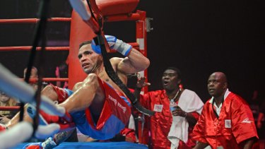 Body blow: Anthony Mundine hits the canvas in Newcastle in April against Joshua Clottey.