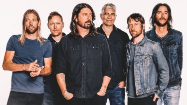 Dave Grohl (centre) brings the Foo Fighters to town in January as part of their world tour.