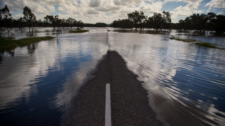 A flooded Newell Highway cuts off Forbes and West Wyalong.