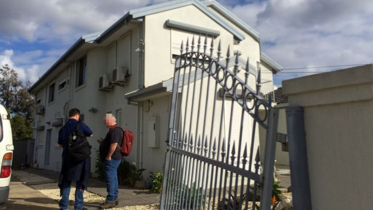AFP officers outside Richard Vong's house in the Melbourne suburb of Thomastown, which was raided on Wednesday.