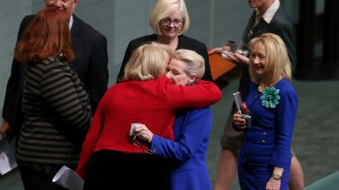 Bronwyn Bishop is embraced by colleagues after the vote to replace her.