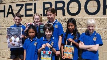 Students wear their Fairtrade polo shirts outside Hazelbrook Public School.