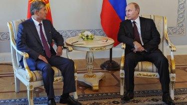 Vladimir Putin and the President of Kyrgyzstan, Almazbek Atambayev attend a meeting in Saint Petersburg.