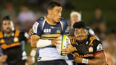 Wharenui Hawera of the Brumbies battles the Chiefs in a trial match.