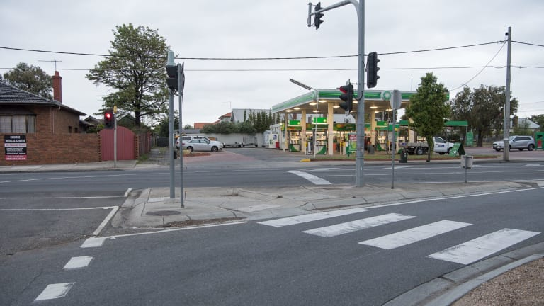 The girl was hit on the road in front of this service station as she crossed over Bell Street.