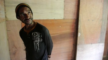 Darius Sohol proudly shows off the new health centre he built in Lolat.
