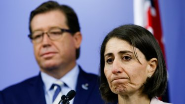 Searching for a path forward on council amalgamations: NSW Premier Gladys Berejiklian and Police Minister Troy Grant.