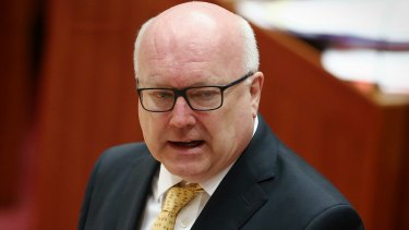Attorney-General George Brandis will have the power to block legal action or appeal an injunction.