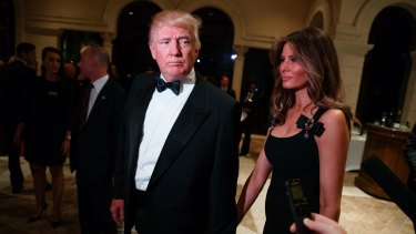 Donald Trump and his wife Melania Trump arrive for a New Year's Eve party at Mar-a-Lago.