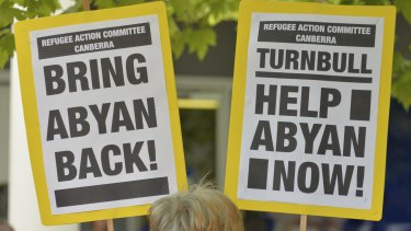Signs at a rally in Canberra urge support for Somali woman and  Nauru asylum seeker Abyan who claims to have been raped, was flown to Australia for an abortion, and then flown back without having had the procedure.