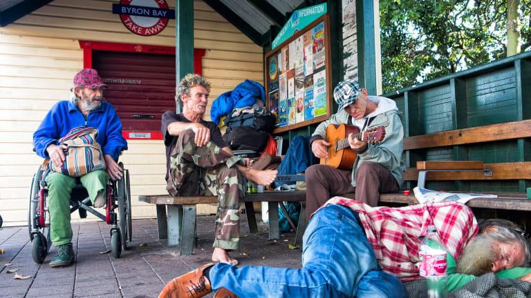 Homeless men at the main bus shelter in Byron Bay.