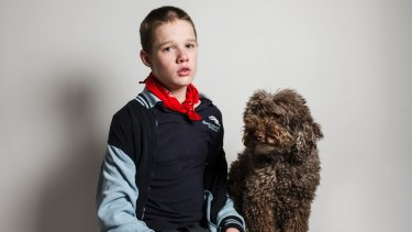 Logan, pictured with his therapy dog Simi, has autism and requires one-on-one care at Marymead's respite service.