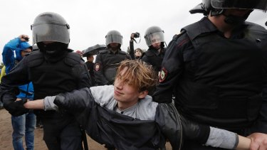 Police detain a protester during a rally in St Petersburg.