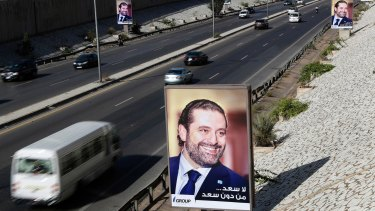 "Posters showing Lebanese Prime Minister Saad Hariri with Arabic that reads, ""No happiness without you Saad,"" hang along the airport highway, in Beirut."