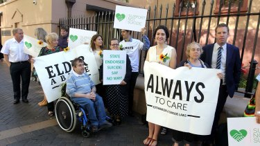 Opponents of the bill standing outside State Parliament on Thursday.