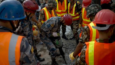 Nepalese Army work to try to dig up a little boy believed to be in the rubble of a Kathmandu house that collapsed following a second major earthquake on Tuesday.