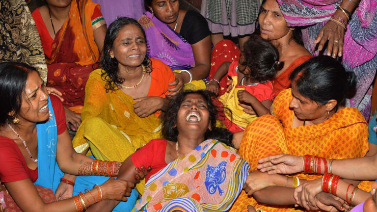 An Indian widow (centre) is comforted by relatives and friends after the death of her husband on the outskirts of Patna on Tuesday, after a new 7.3 earthquake and several powerful aftershocks hit neighbouring devastated Nepal.