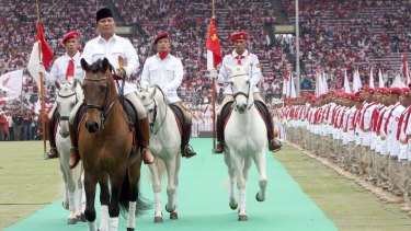Opposition leader Prabowo Subianto, left, has been approached by Indonesian President Joko Widodo in an appeal for calm ahead of Friday's protest.