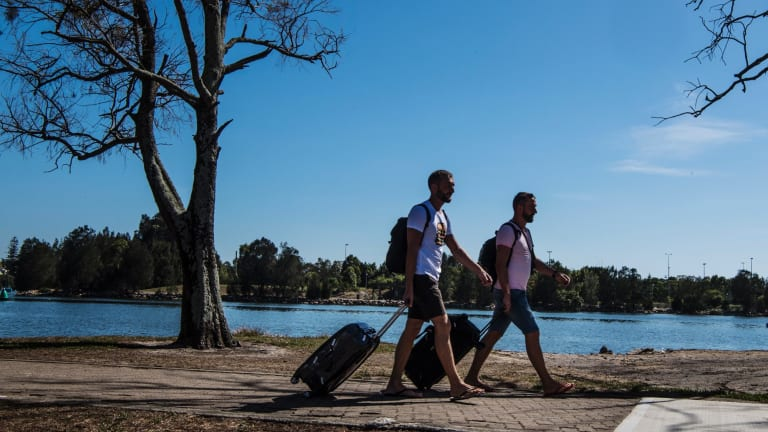 Polish tourists Tom and Andrew walking from Wolli Creek station to Sydney Airport.
